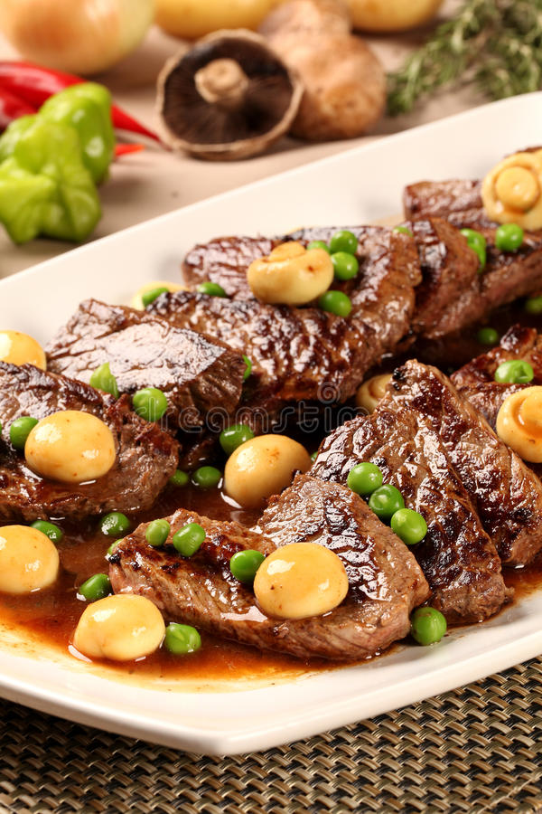 Steak with champignon. Gourmet food royalty free stock photography
