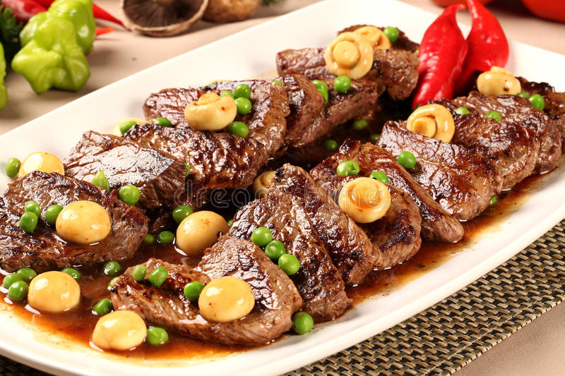Steak with champignon. Gourmet meal dish royalty free stock photos