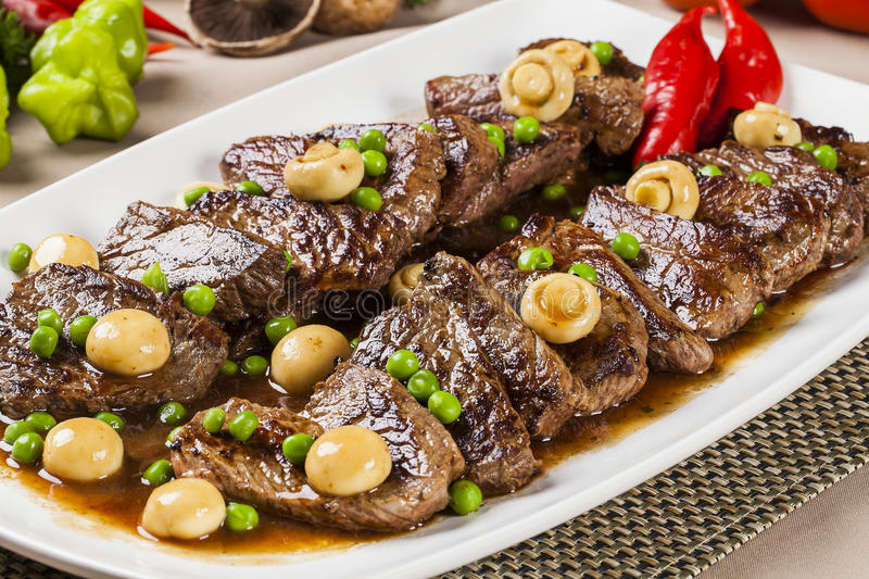 Steak with champignon. Meal dish royalty free stock photography