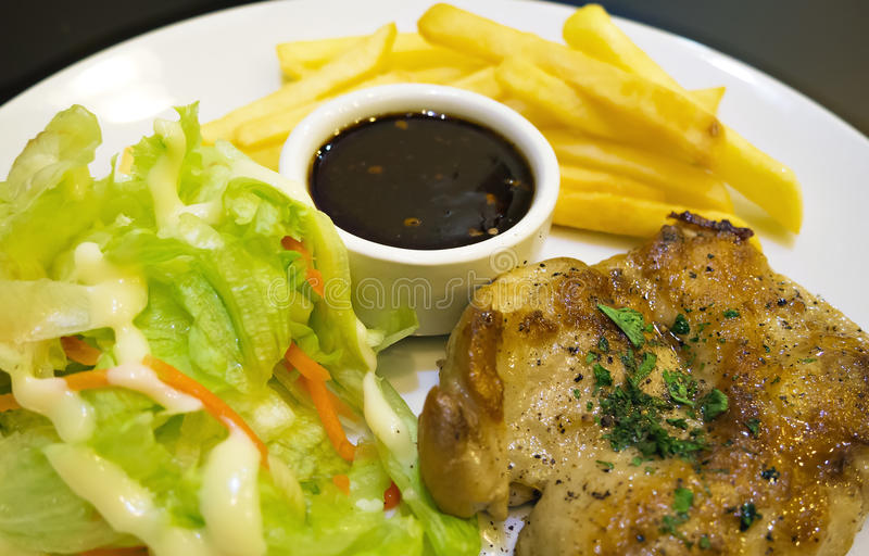 Steak. Chicken Steak with Salad and French Fried stock images