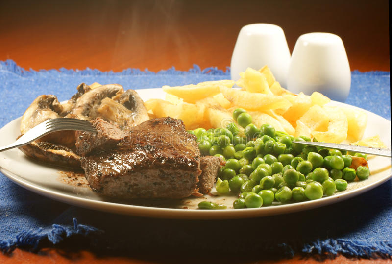 Steak and chips. royalty free stock photos