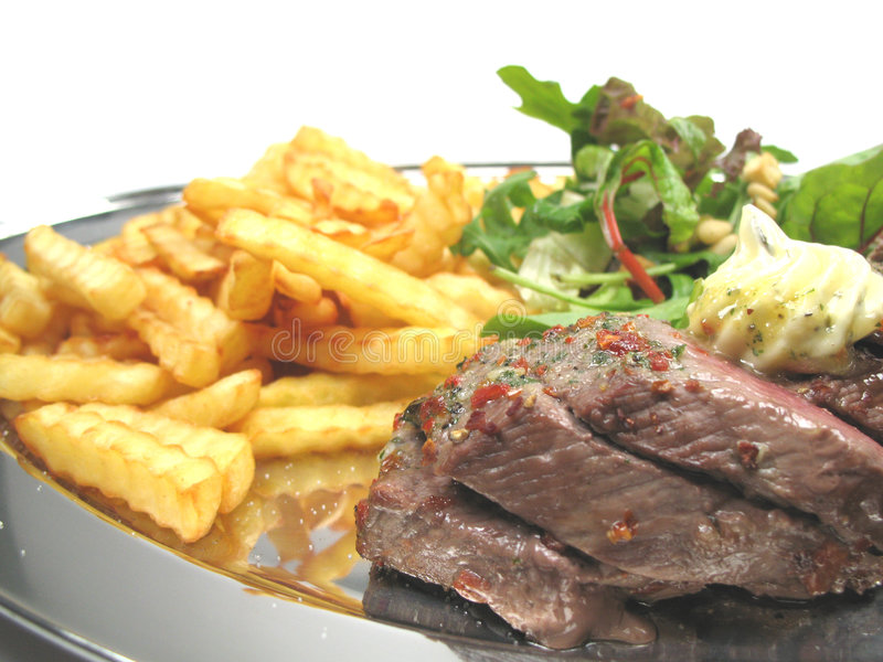 Steak and chips. Some juicy steaks and chips on a tray stock photography