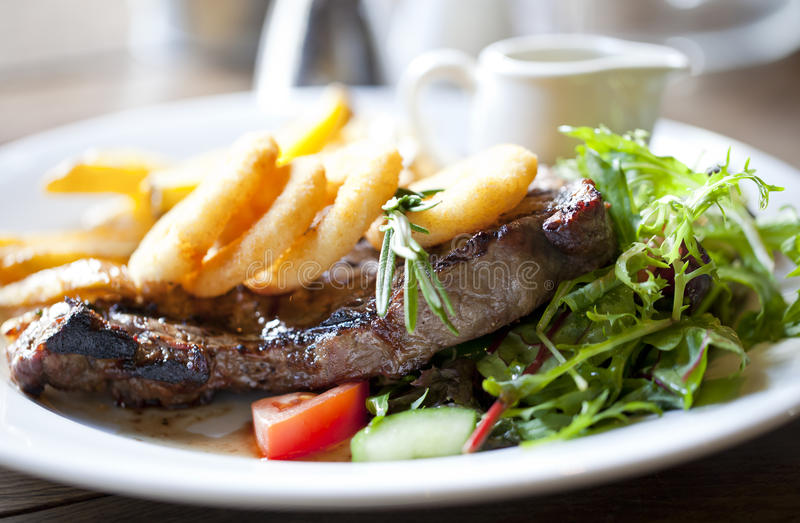 Steak and chips stock photos