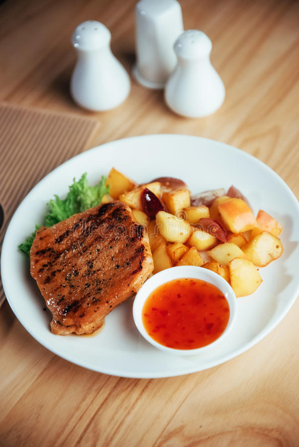 Steak with crispy golden fries and tomato spicy sauce.  stock photos