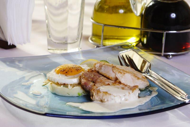 Steak with egg yolk stock images