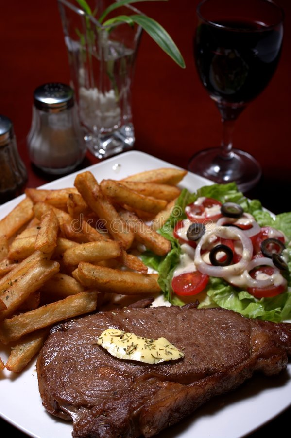 Steak and french fries royalty free stock photo