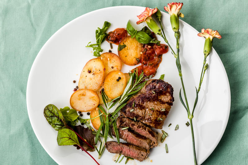 Steak with fried potatoes royalty free stock images