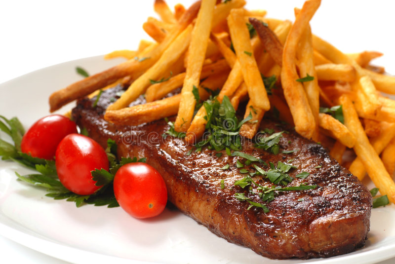 Steak and Fries royalty free stock photos