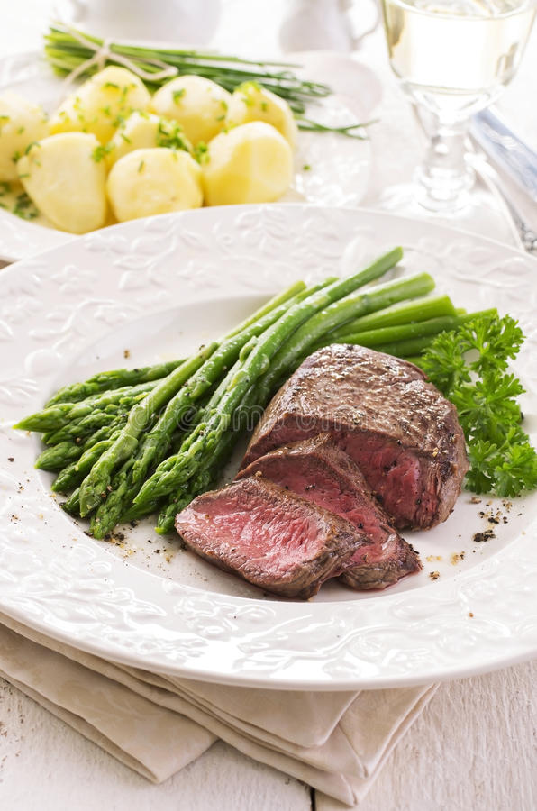 Steak with Green Asparagus royalty free stock photo