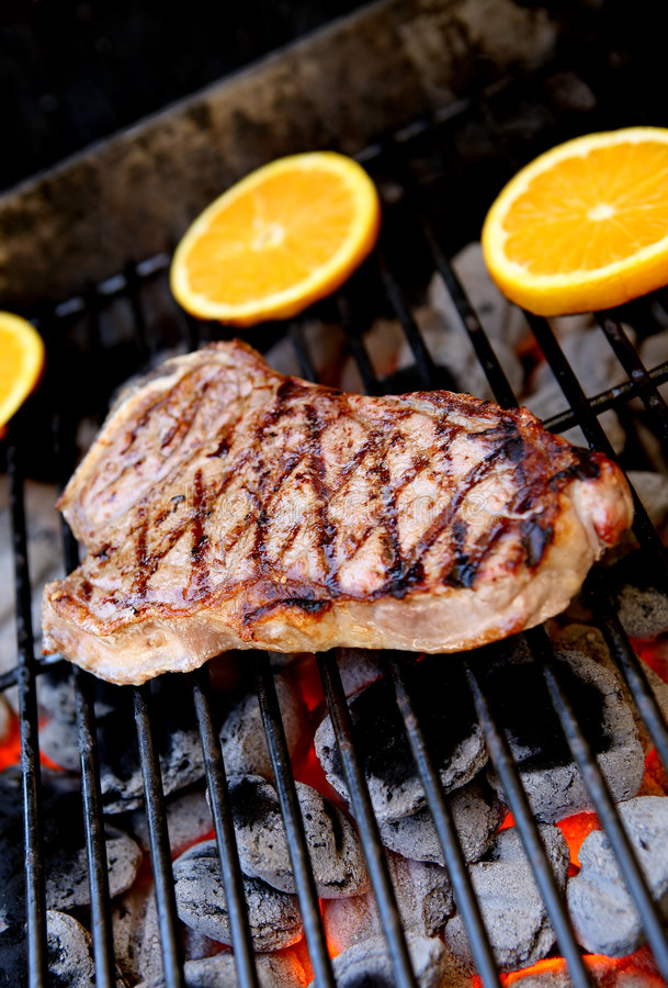 Steak on Grill. A delicious looking steak cooking on the grill