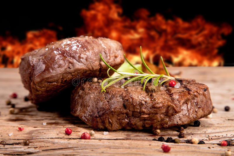Steak. Grilled steaks on white background stock image