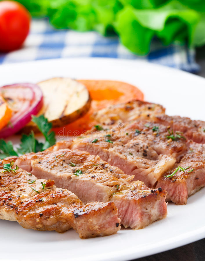 Steak with grilled vegetables on a plate royalty free stock photography