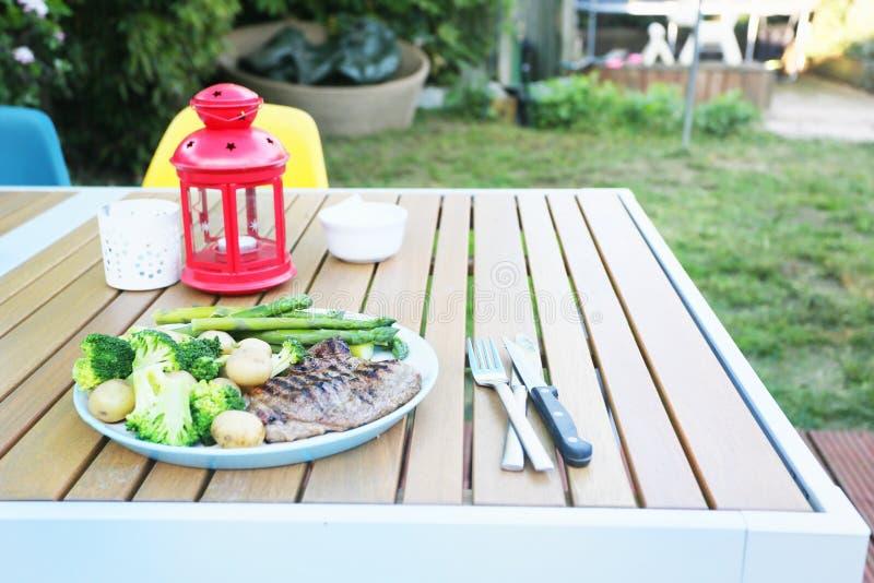 Steak meal in the garden stock photos