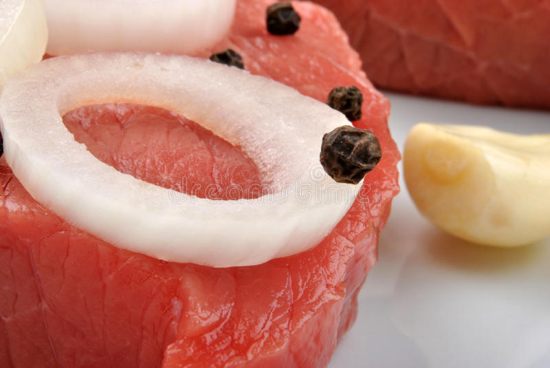 steak meat with some organic onion royalty free stock image