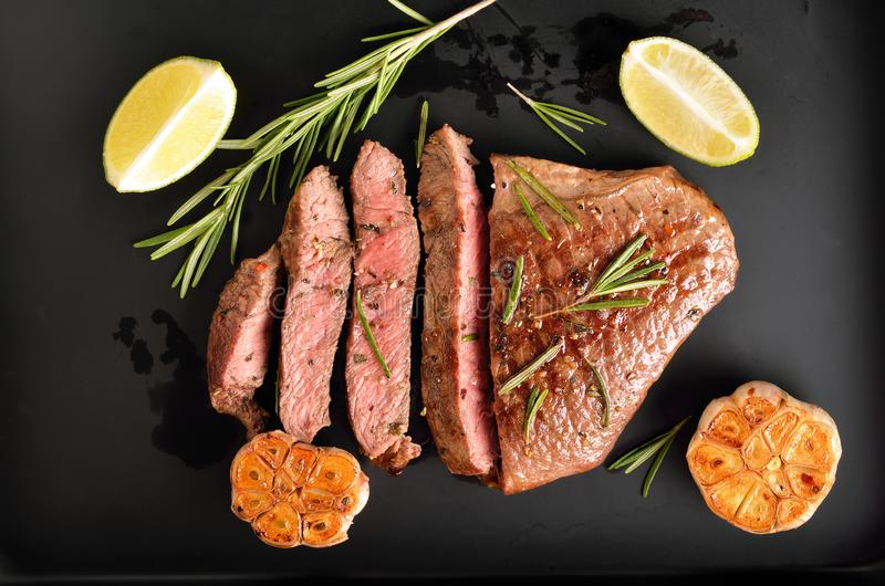 Steak medium rare beef with spices stock image