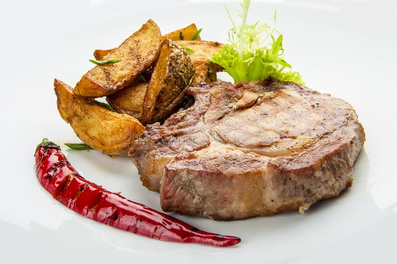 Steak from pork chop with potatoes royalty free stock image