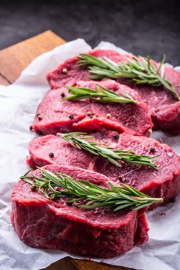 Steak. Raw beef steak. Fresh raw Sirloin beef steak sliced o Herb - Rosemary decoration.  stock photography