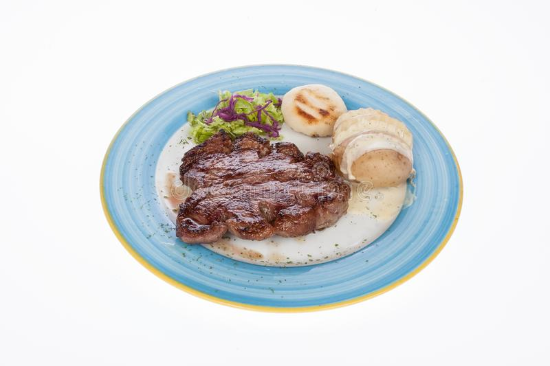 Steak roast beef with steamed potatoes. On white background stock photos