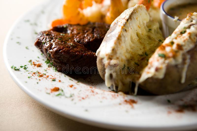 Steak and shrimps stock image