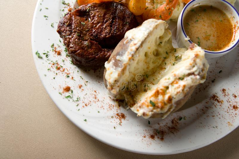 Steak and shrimps stock photography