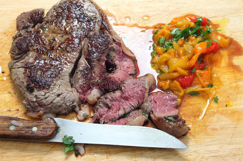 Download Steak sliced on a board stock image. Image of rare, pepper - 26094899