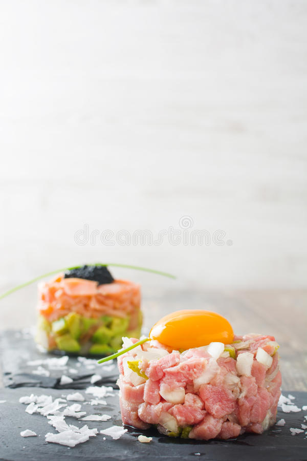 Steak tartar and salmon tartar royalty free stock photography