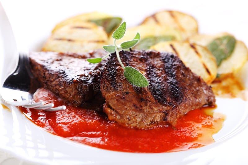 Steak with tomato sauce royalty free stock photos