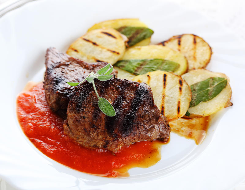 Steak with tomato sauce stock photo