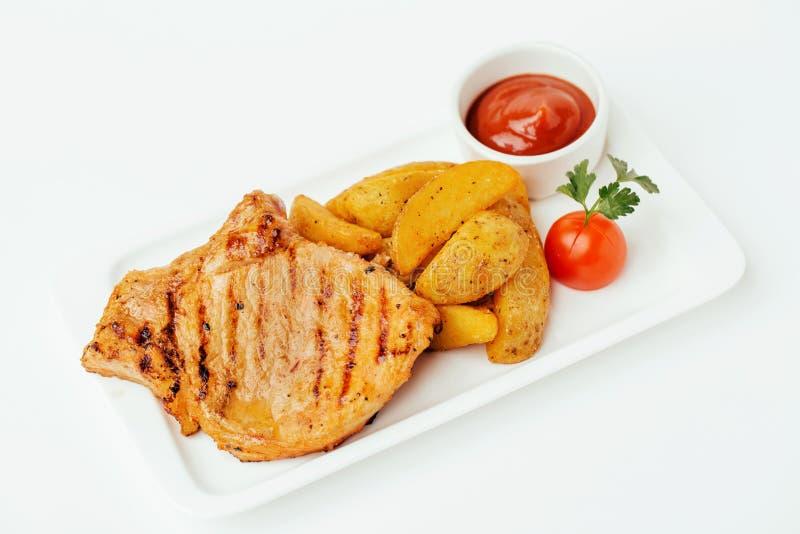 Steak with Tomato Sauce and potatos stock images