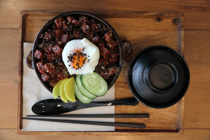 Steak tuna on rice with egg Japanese style. On wooden tray stock photo