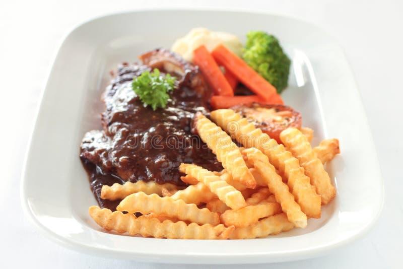 Steak und Chips stockbild