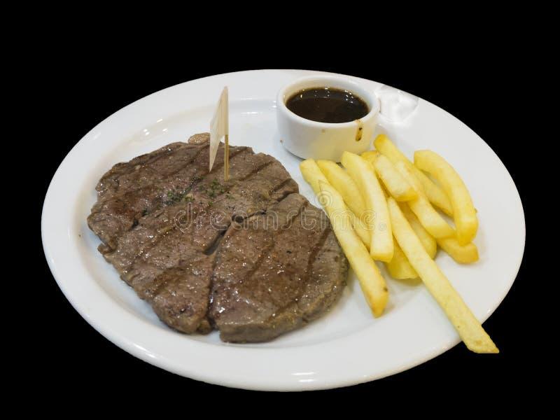 Steak und gebraten auf einem Teller stockfotos