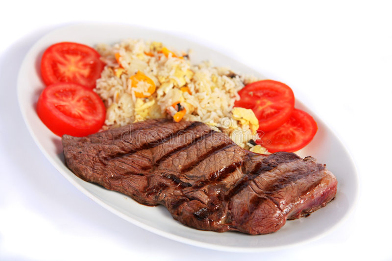 Steak und gebratener Reis horizontal lizenzfreie stockfotografie