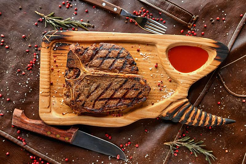 Steak on a wooden board royalty free stock photo
