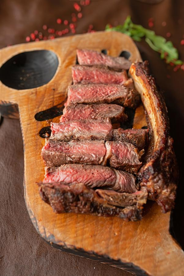 Steak on a wooden board royalty free stock images