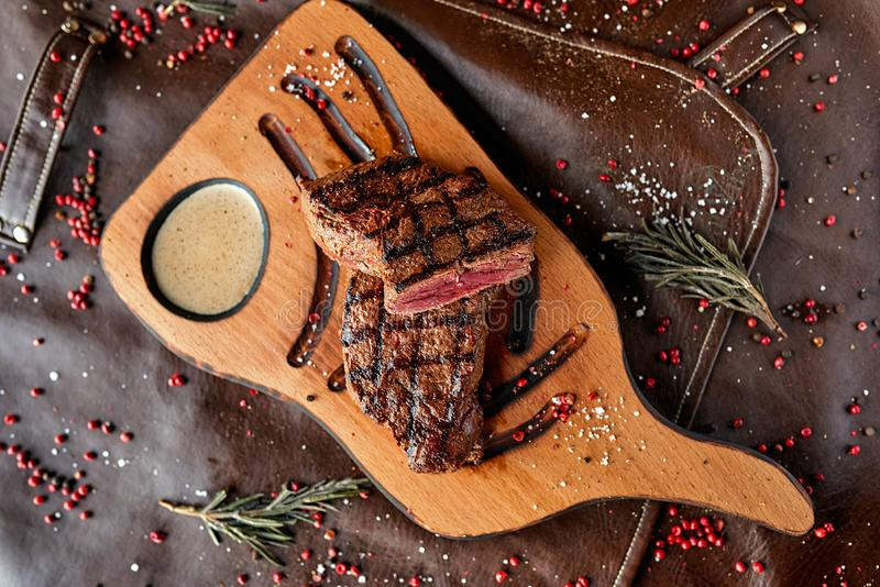 Steak on a wooden board stock photography
