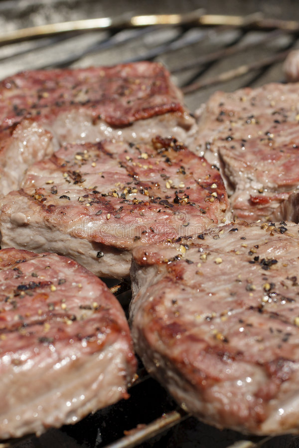 Download Steaks on barbecue grill stock photo. Image of cooking - 5198712