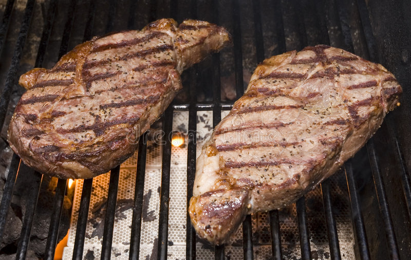 Steaks on the Grill royalty free stock photo
