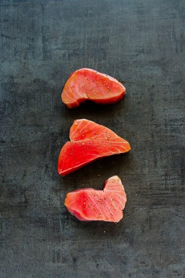 Tuna fish steaks stock photos
