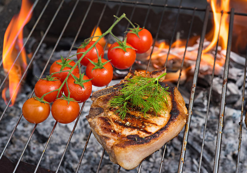 Steaks and tomato BBQ stock photos