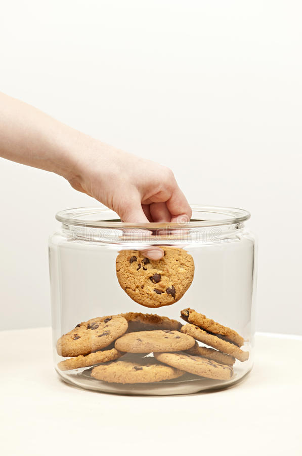 Stealing cookies from the cookie jar stock image
