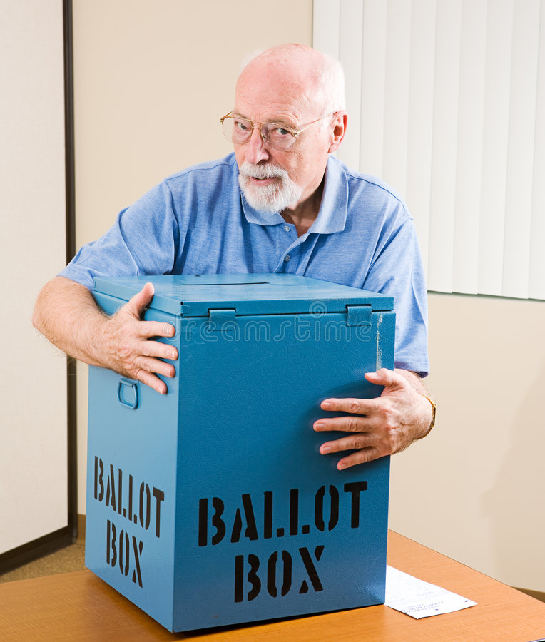 Stealing the Election. Senior man stealing a ballot box from an election polling place stock images