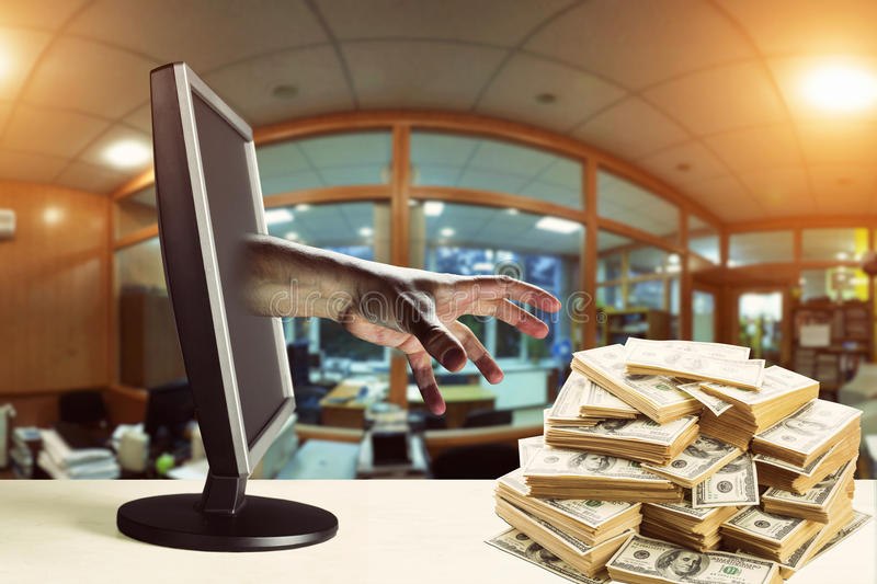 Stealing money. Hand coming out of a monitor and stealing money stock image