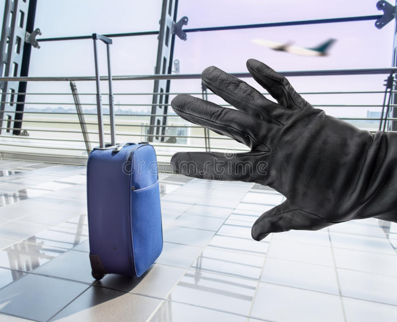Stealing a suitcase stock image