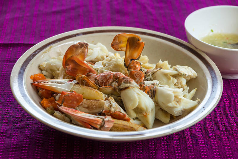 Steam and boil crabs with seafood spicy sauce. On purple background royalty free stock image