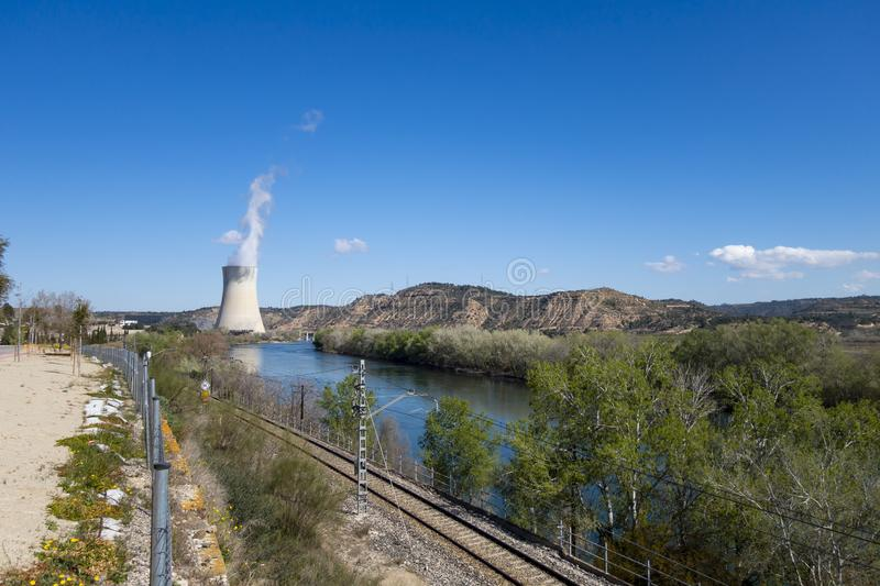 Steam chimney in a power nuclear plant. Next to the river royalty free stock image