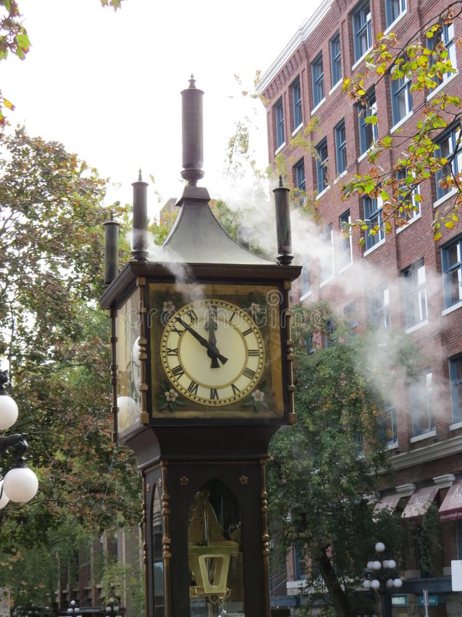 Steam Clock. The steam clock, as its name implies runs on steam. It is located in Gastown in Vancouver, Canada and is a big tourist attraction stock images
