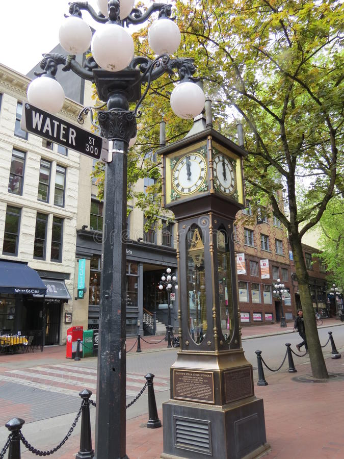 Steam Clock. The Steam Clock is, as its name suggests, powered by steam. It is located in Gastown, a suberb of Vancouver, Canada and is a big tourist attracton stock photo