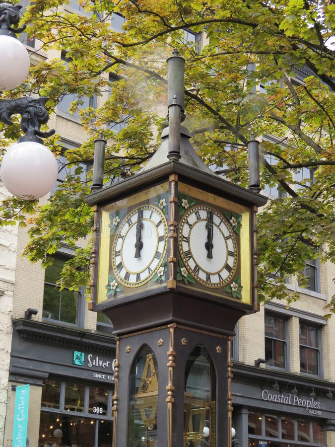 Steam Clock. The Steam Clock is, as its name suggests, powered by steam. It is located in Gastown, a suberb of Vancouver, Canada and is a big tourist attracton stock photography