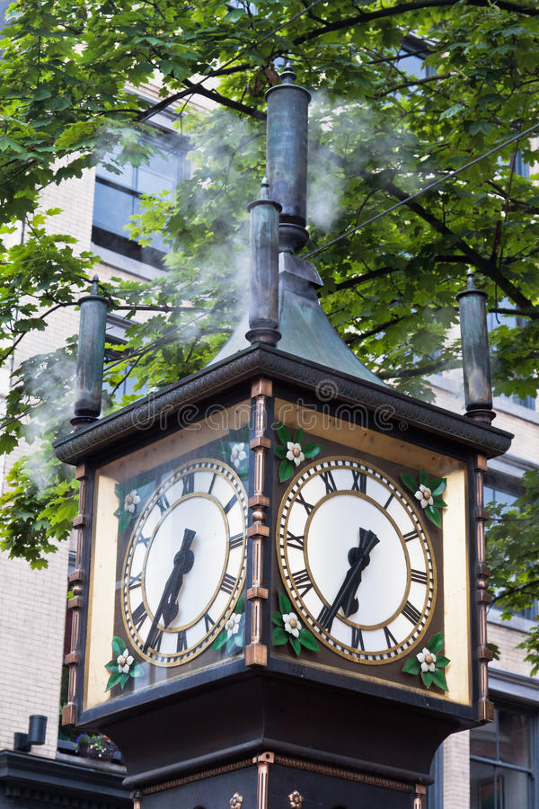 Steam Clock in Gastown Vancouver. The famous Steam Clock and the historical buildings in Gastown, downtown Vancouver, British Columbia, west coast of Canada stock images